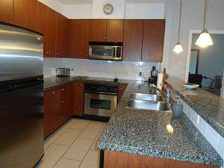 Photo 4: 104 100 CAPILANO Road in Port Moody: Port Moody Centre Condo for sale : MLS®# V1101530