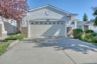 Photo 1: 55 CEDUNA Park SW in Calgary: Cedarbrae Duplex for sale : MLS®# A1015320