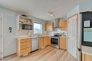 Photo 8: 108 Bridleridge Gardens SW in Calgary: Bridlewood Detached for sale : MLS®# A1071298