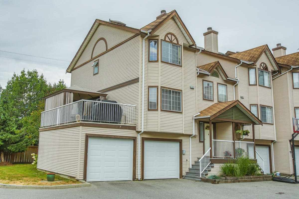 End unit with double garage and large deck.