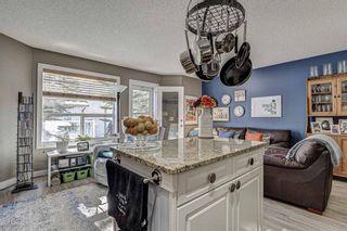 Photo 9: 183 Mt Douglas Manor SE in Calgary: McKenzie Lake Row/Townhouse for sale : MLS®# A1071755
