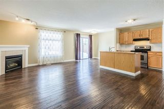 Photo 5: 23 TUSCARORA WY NW in Calgary: Tuscany House for sale : MLS®# C4174470