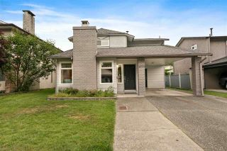 """Photo 1: 1970 BOW Drive in Coquitlam: River Springs House for sale in """"RIVER SPRINGS"""" : MLS®# R2589656"""