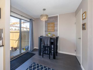 Photo 11: 55 123 Queensland Drive SE in Calgary: Queensland Row/Townhouse for sale : MLS®# A1101736