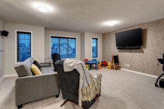 Photo 10: 144 Cougar Ridge Manor SW in Calgary: Cougar Ridge Detached for sale : MLS®# A1098625