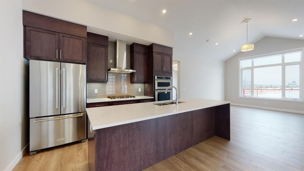 Photo 12: Photos: 38 Crestridge Bay SW in Calgary: Crestmont Row/Townhouse for sale : MLS®# A1073636