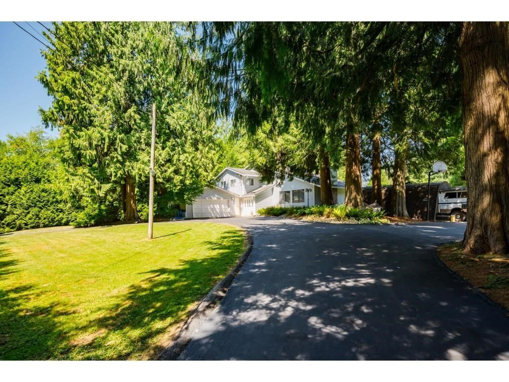 Photo 2: Photos: 26019 58 Avenue in Langley: County Line Glen Valley House for sale : MLS®# R2599684