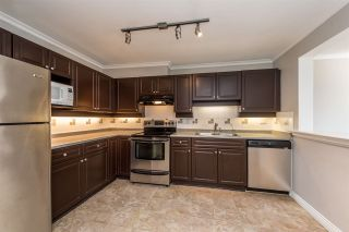 """Photo 1: 313 1669 GRANT Avenue in Port Coquitlam: Glenwood PQ Condo for sale in """"THE CHARLES"""" : MLS®# R2208270"""