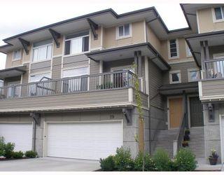 "Photo 1: 29 40632 GOVERNMENT Road in Squamish: Garibaldi Estates Townhouse for sale in ""Rivers Walk"" : MLS®# V772950"