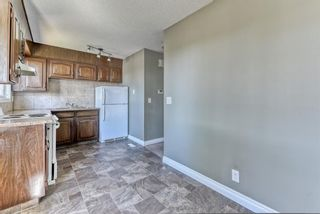 Photo 7: 218 Storybook Terrace NW in Calgary: Ranchlands Row/Townhouse for sale : MLS®# A1126980