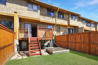 Photo 17: 1433 Ranchlands Road NW in Calgary: Ranchlands Row/Townhouse for sale : MLS®# A1128096