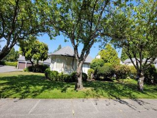 """Main Photo: 103 15519 87A Avenue in Surrey: Fleetwood Tynehead Townhouse for sale in """"Evergreen Estates"""" : MLS®# R2600368"""