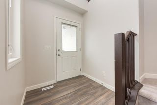 Photo 2: 65 Tuscany Ridge Mews NW in Calgary: Tuscany Detached for sale : MLS®# A1152242