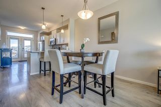 Photo 7: 100 Legacy Main Street SE in Calgary: Legacy Row/Townhouse for sale : MLS®# A1095155
