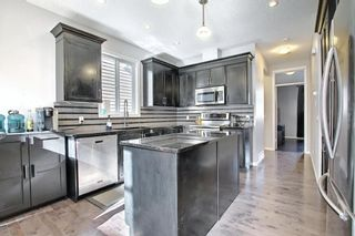 Photo 2: 19 AUTUMN View SE in Calgary: Auburn Bay Detached for sale : MLS®# A1076739