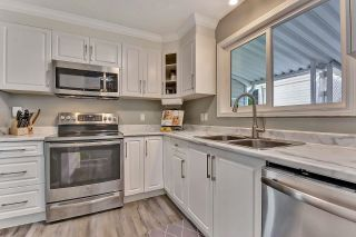 """Photo 12: 39 2345 CRANLEY Drive in Surrey: King George Corridor Manufactured Home for sale in """"LA MESA"""" (South Surrey White Rock)  : MLS®# R2601872"""