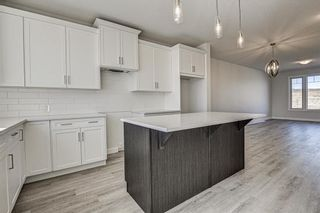 Photo 12: 132 Creekside Drive SW in Calgary: C-168 Semi Detached for sale : MLS®# A1098272