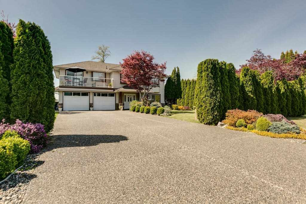 "Main Photo: 12403 188 Street in Pitt Meadows: West Meadows House for sale in ""HIGHLAND PARK AREA"" : MLS®# R2261078"