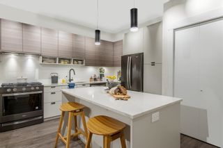 """Photo 3: A416 20727 WILLOUGHBY TOWN Centre in Langley: Willoughby Heights Condo for sale in """"The Residences at Willoughby Town Centre"""" : MLS®# R2603751"""