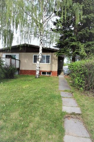 Main Photo: 3318A 38 Street SW in Calgary: Glenbrook House for sale : MLS®# C4120224