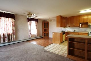 Photo 4: 404 4514 54 Avenue: Olds Apartment for sale : MLS®# A1130006