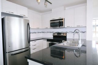 "Photo 3: 502 7478 BYRNEPARK Walk in Burnaby: South Slope Condo for sale in ""GREEN"" (Burnaby South)  : MLS®# R2021457"