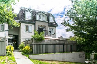 """Photo 1: 101 219 BEGIN Street in Coquitlam: Maillardville Townhouse for sale in """"PLACE FOUNTAINEBLEU"""" : MLS®# R2090733"""