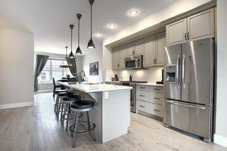 Photo 6: 374 Quarry Park Boulevard SE in Calgary: Douglasdale/Glen Row/Townhouse for sale : MLS®# A1063797