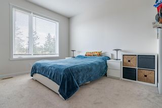 Photo 23: 145 Shawnee Common SW in Calgary: Shawnee Slopes Row/Townhouse for sale : MLS®# A1097036