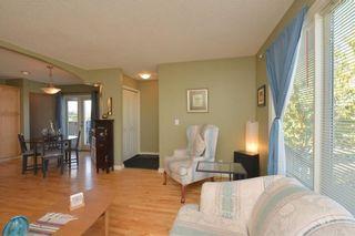 Photo 5: 267 GLENPATRICK Drive: Cochrane House for sale : MLS®# C4139469