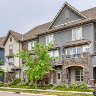 Main Photo: 440 Quarry Way SE in Calgary: Douglasdale/Glen Row/Townhouse for sale : MLS®# A1126599