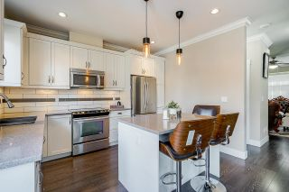 """Photo 12: 10 6929 142 Street in Surrey: East Newton Townhouse for sale in """"Redwood"""" : MLS®# R2603111"""