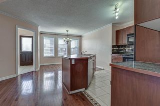 Photo 8: 64 Eversyde Circle SW in Calgary: Evergreen Detached for sale : MLS®# A1090737