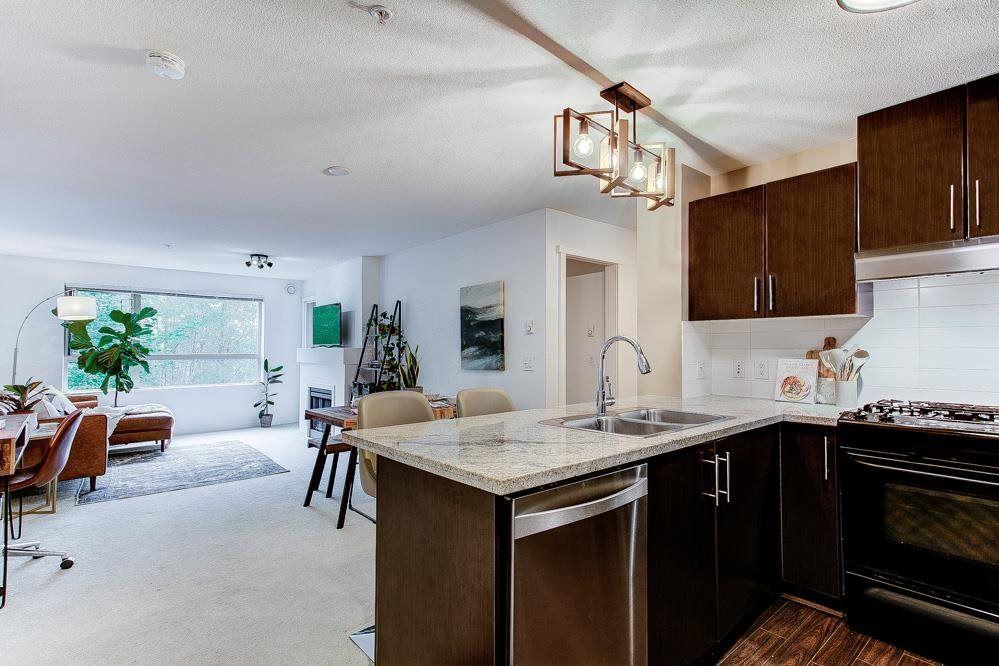 "Main Photo: 221 700 KLAHANIE Drive in Port Moody: Port Moody Centre Condo for sale in ""Boardwalk at Klahanie"" : MLS®# R2573204"