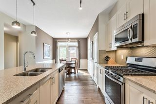 Photo 7: 17 Sherwood Row NW in Calgary: Sherwood Row/Townhouse for sale : MLS®# A1137632