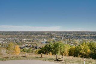 Photo 10: 40 Cougar Ridge Landing SW in Calgary: Cougar Ridge Row/Townhouse for sale : MLS®# A1148928