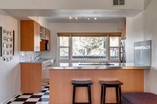 Main Photo: 1 1634 18 Avenue NW in Calgary: Capitol Hill Apartment for sale : MLS®# A1097825