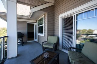 """Photo 14: 413 17712 57A Avenue in Surrey: Cloverdale BC Condo for sale in """"West on the Village Walk"""" (Cloverdale)  : MLS®# R2107869"""