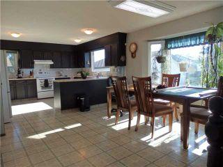 Photo 4: 1318 Murdoch Street: Crossfield Residential Detached Single Family for sale : MLS®# C3629322