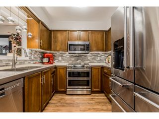 """Photo 9: 204 32098 GEORGE FERGUSON Way in Abbotsford: Abbotsford West Condo for sale in """"Heather Court"""" : MLS®# R2399610"""