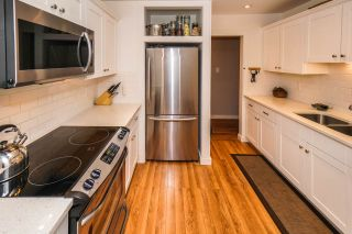 """Photo 7: 101 601 NORTH Road in Coquitlam: Coquitlam West Condo for sale in """"WOLVERTON"""" : MLS®# R2498798"""