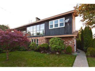 Main Photo: 775 CLARKE Road in Coquitlam: Coquitlam West 1/2 Duplex for sale : MLS®# R2615210