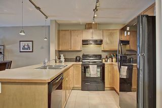 Photo 2: 2108 92 Crystal Shores Road: Okotoks Apartment for sale : MLS®# A1068226