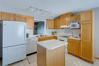 Photo 14: 105 Rocky Ridge Court NW in Calgary: Rocky Ridge Row/Townhouse for sale : MLS®# A1069587