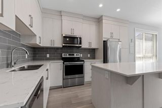Photo 13: 903 Redstone Crescent NE in Calgary: Redstone Row/Townhouse for sale : MLS®# A1096519