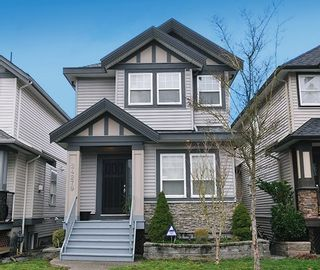 """Photo 1: 24279 101A Avenue in Maple Ridge: Albion House for sale in """"CASTLE BROOK"""" : MLS®# R2041174"""