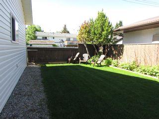 Photo 4: 209 9 Avenue NE: Sundre Detached for sale : MLS®# A1120415
