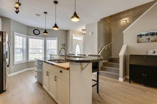 Photo 7: 93 SOMME Boulevard SW in Calgary: Garrison Woods Row/Townhouse for sale : MLS®# C4241800