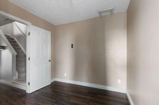 Photo 9: 311 Bridlewood Lane SW in Calgary: Bridlewood Row/Townhouse for sale : MLS®# A1136757