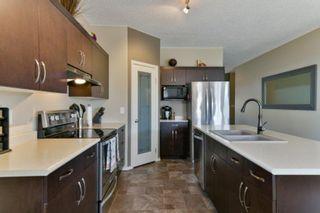 Photo 3: 205 Ravensden Drive in Winnipeg: River Park South Residential for sale (2F)  : MLS®# 202112021